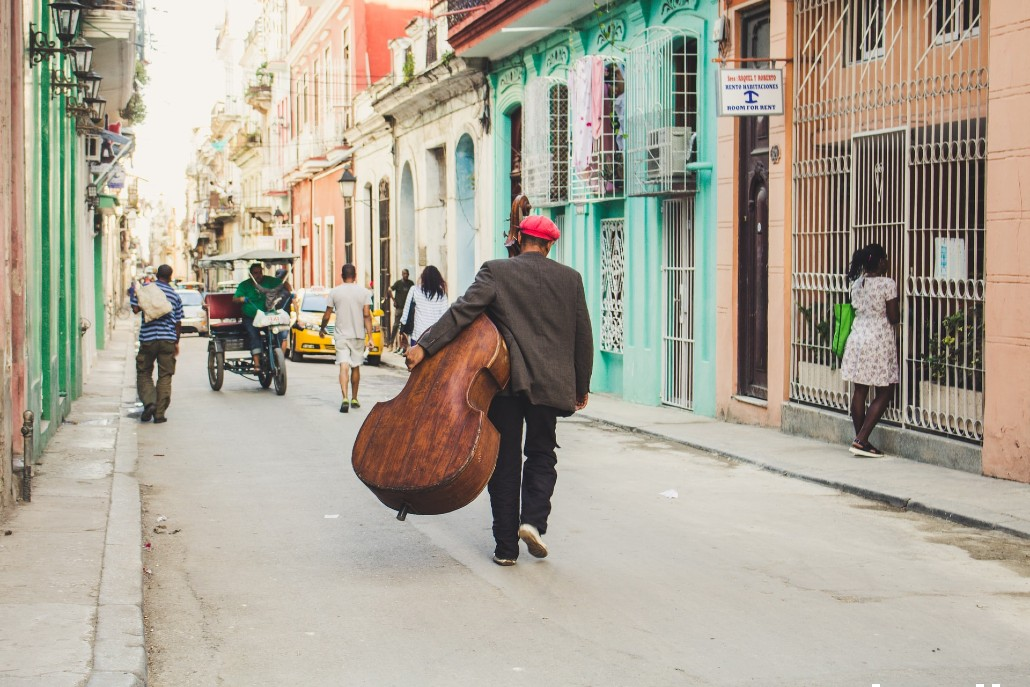 Man Carrying Instrument in Cuba